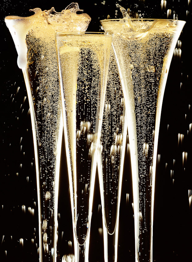 Sainsbury's image of champagne in flutes fizzing and splashing, liquid photography, liquid photographer, champaign photography, drinks photographer, bubbles and splashes, product still life, still-life photography, still-life photographer, still-life photographer London, David Parfitt, advertising photographer