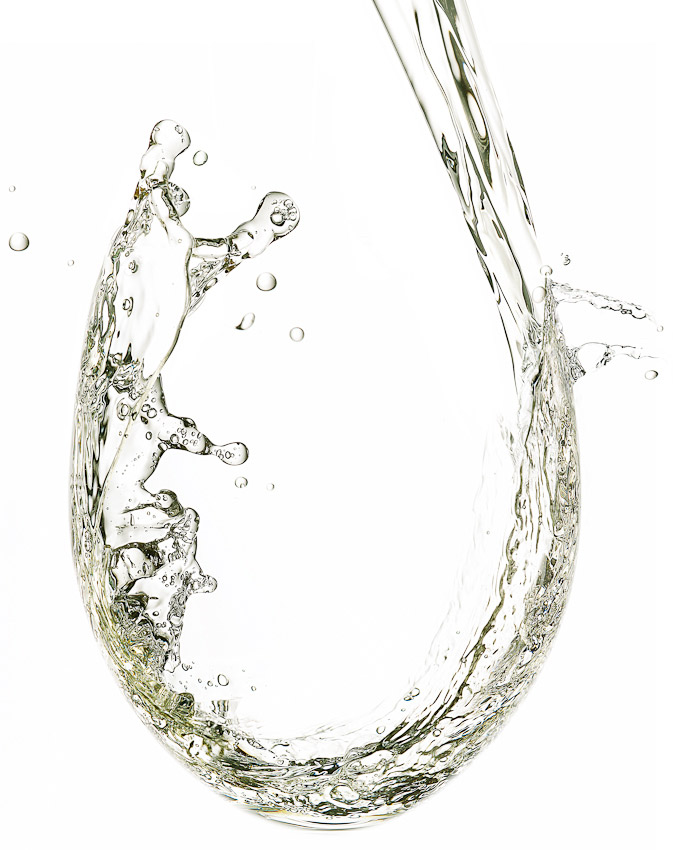 white wine pouring into a glass, wine photography, liquid photography, drinks photography, water photography, still life photography, David Parfitt, still-life, still-life photography, still-life photographer, still-life photographer London, David Parfitt, advertising photographer
