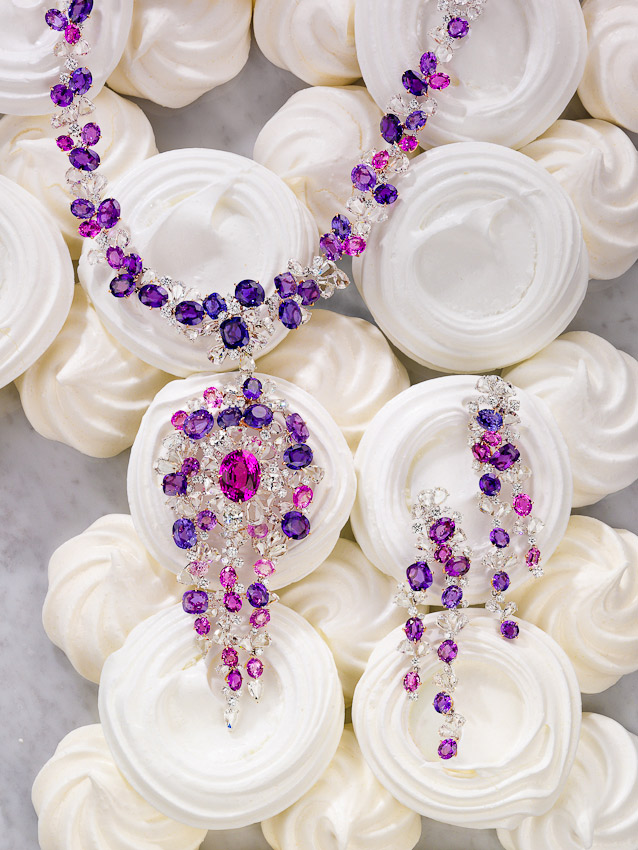 Moussaieff Jewellers, precious purple stones, Necklace and earrings laid out on white meringues, still-life photographer, still-life photography, still-life photographer London,  jewellery photographer, jewelry photographer jewellery photography, Tatler promotions, Tatler photographer, David Parfitt