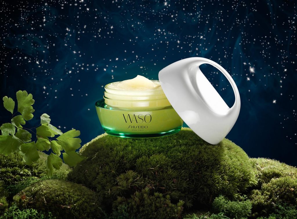 Shiseido face cream pot against a starry night sky